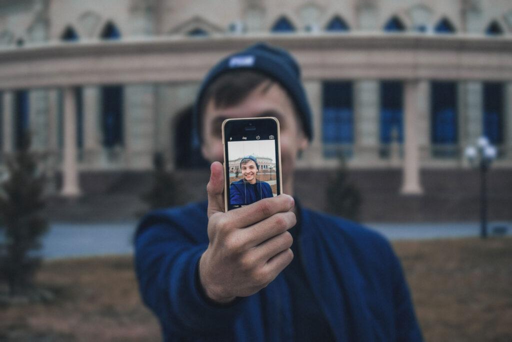 guy making selfie video